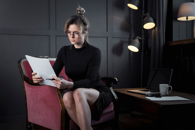 Professional businesswoman looking into papers Free Photo