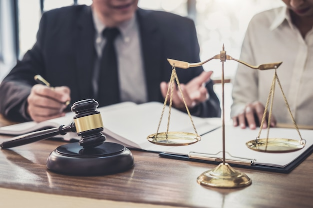 Professional businesswoman and male lawyers working and discussion having at law firm Premium Photo