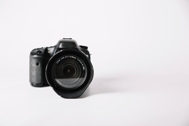Professional camera on white background Free Photo