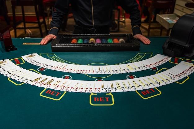 Professional croupier during cards Premium Photo