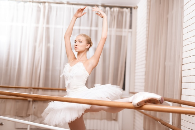 Professional dancer rehearses near ballet barre. Premium Photo