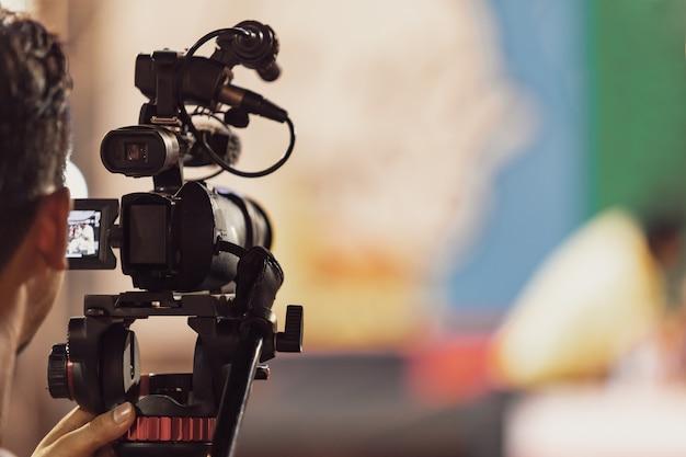 Professional digital camera recording video in music concert festival Premium Photo