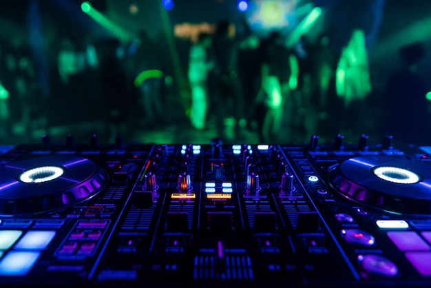 Professional dj mixer controller for mixing music in a nightclub Premium Photo