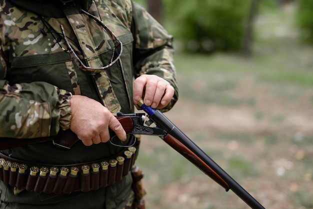 Professional hunter charging gun with cartridge. Premium Photo