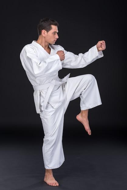 Professional karate fighter kicking. Premium Photo