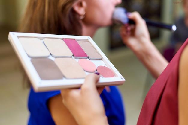 Professional make-up in a beauty studio. Premium Photo