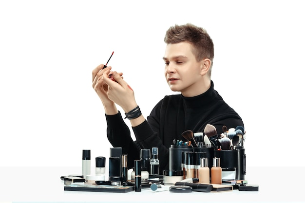 Professional makeup artist with tools isolated on white  space Free Photo