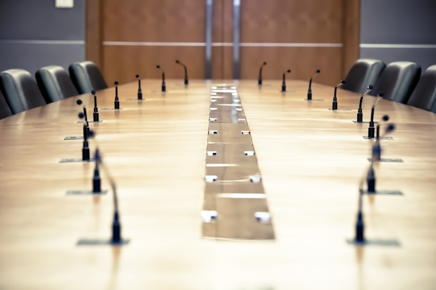 Professional meeting microphone on the table. Premium Photo