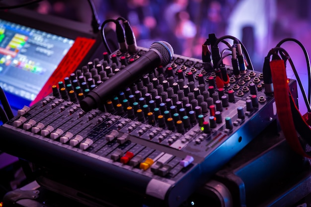 Professional mixing console at a concert. remote control for sound engineer. Premium Photo