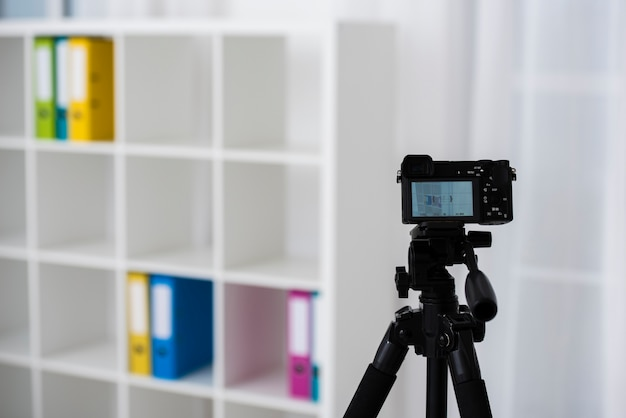 Professional tripod with modern camera Free Photo