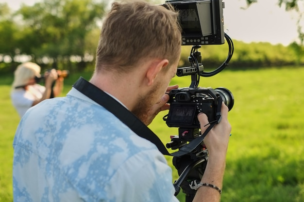 Professional videographer recording with a professional video camera decoder and broadcast. Premium Photo