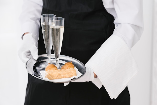 Professional waiter carrying tray Free Photo