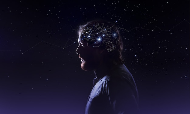 Profile of a bearded man head with  symbol neurons in brain. thinking like stars, the cosmos inside human, background night sky Premium Photo