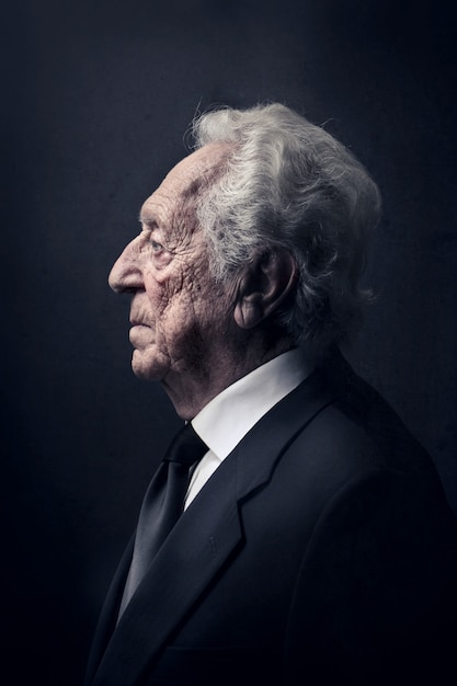 Profile of an old man Premium Photo