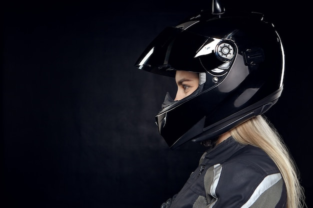 Profile portrait of fashionable young european woman rider with blonde hair Free Photo