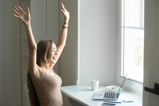 Profile portrait of a woman celebrating success Free Photo