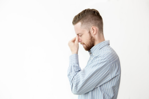 Profile of serious young man thinking deep Free Photo
