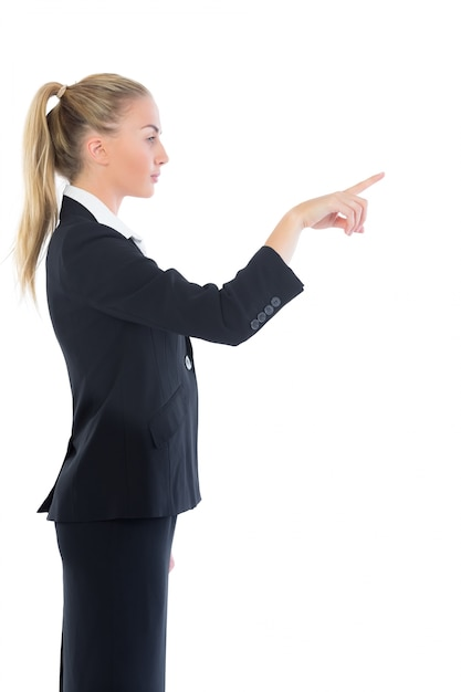 Profile View Of Attractive Blonde Businesswoman Pointing