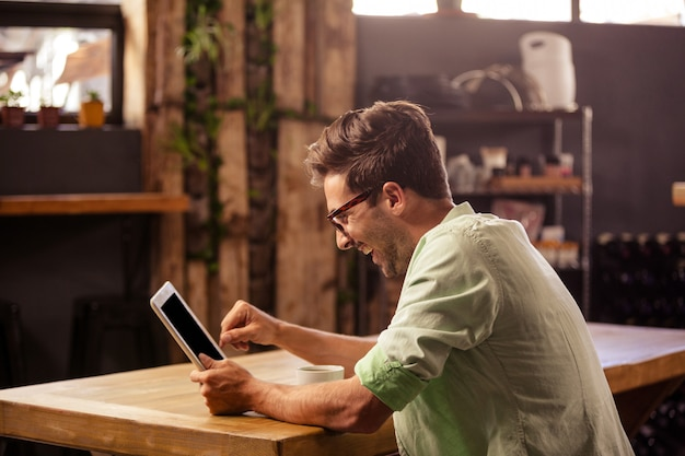 Profile view of hipster man using tablet Premium Photo