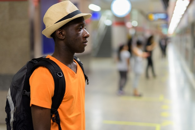 Profile view of young tourist man waiting for train in the subway of bangkok thailand Premium Photo