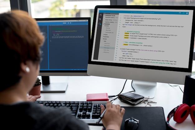 Programmer working with computer software Premium Photo