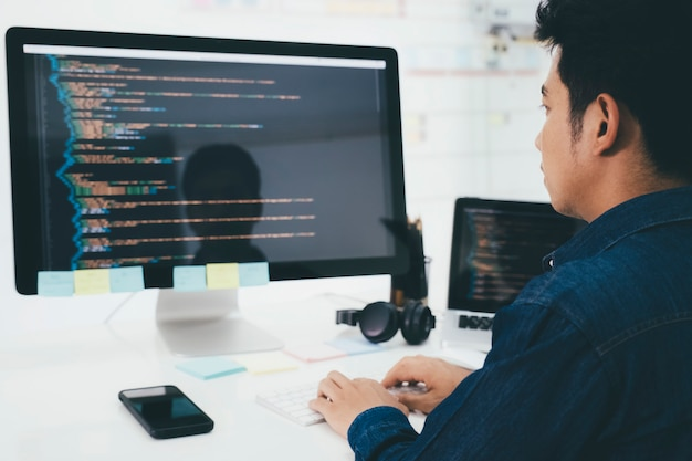 Programmers and developer teams are coding and developing software Premium Photo