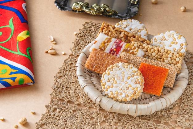 Prophet muhammad birthday celebration desserts, egyptian culture Premium Photo