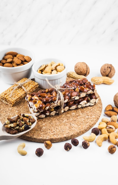 Protein bar with dried fruits on white backdrop Free Photo