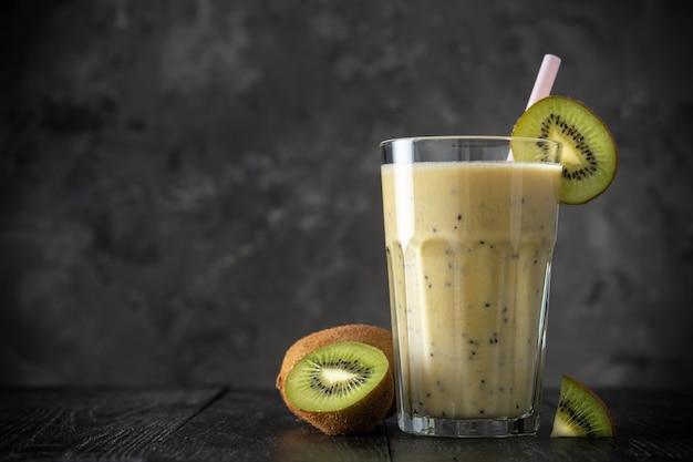 Protein shake with kiwi on a dark background. fresh milkshake with kiwi. smoothies. Premium Photo
