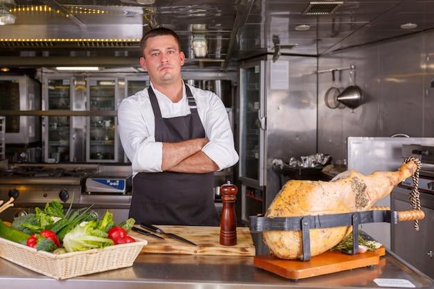 Proud chef in a restaurant kitchen Premium Photo