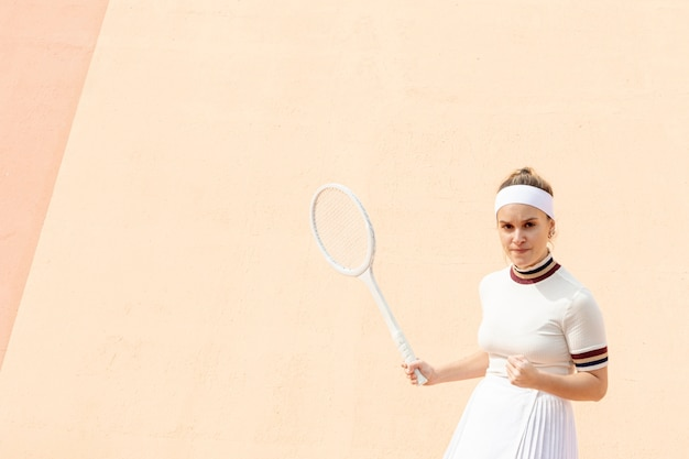 Proud female tennis player of results Free Photo