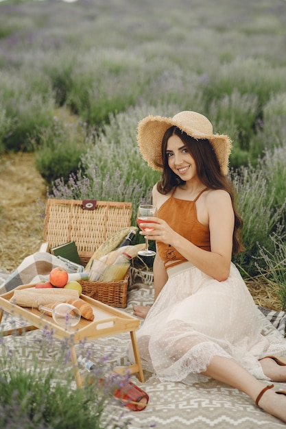 Provence woman relaxing in lavender field. lady in a picnic. Free Photo