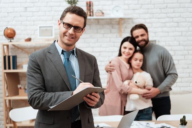 Psychologist make note happy family on background. Premium Photo