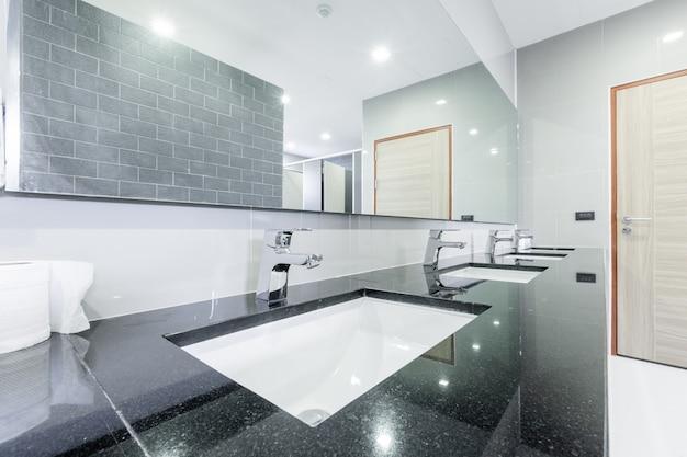 Public interior of bathroom with sink basin faucet Premium Photo