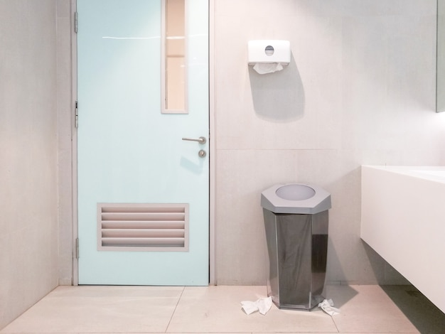Public toilet and there was paper scattered all over the floor. Premium Photo