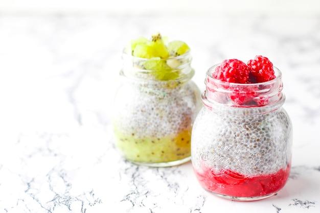 Pudding with berries,  raspberry sauce,  kiwi sauce,  frozen raspberries and blackberries and kiwi slices Premium Photo