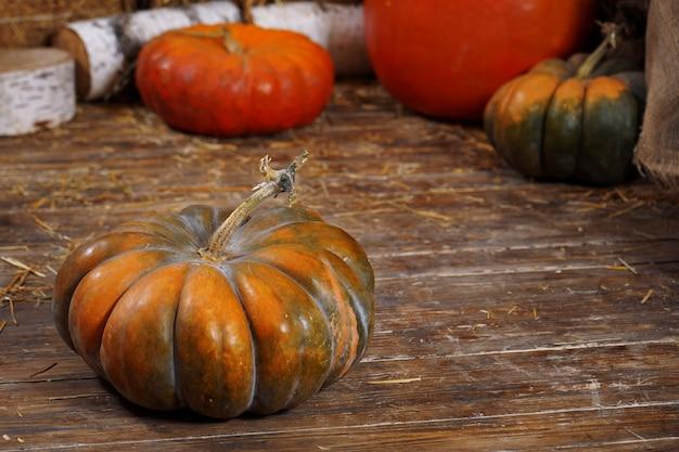 Pumpkin, hay, wooden . background vegetable ribbed orange sleek hay farmer  base rustic  seasonal Premium Photo