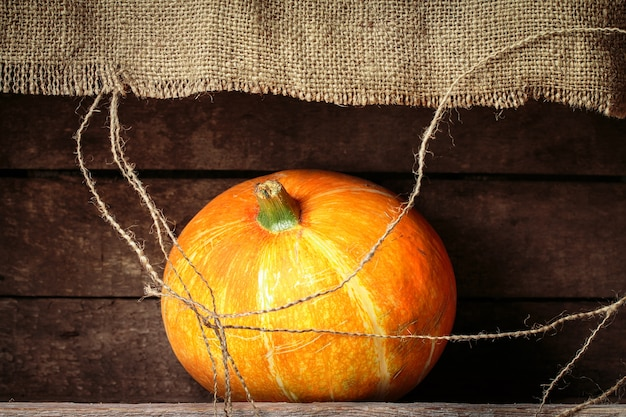 Pumpkin  on a old wooden table Premium Photo