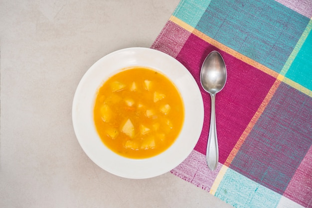 Pumpkin puree and spoon on tabletop Free Photo