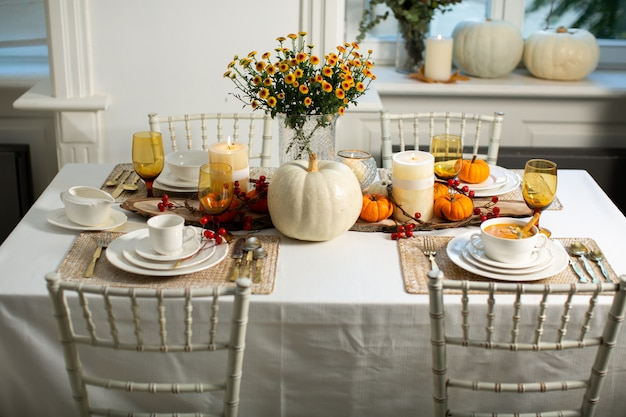 Pumpkin set on the table Free Photo