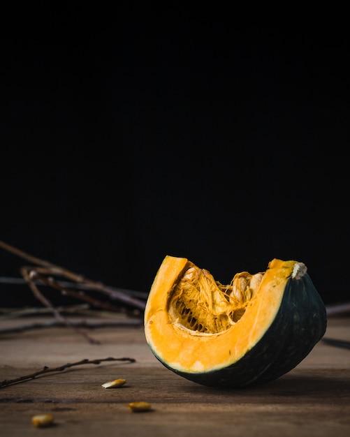 Pumpkin slice on wooden table. copyspace Free Photo