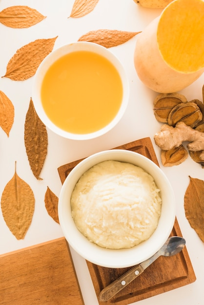 Pumpkin soup and potato puree on table Free Photo