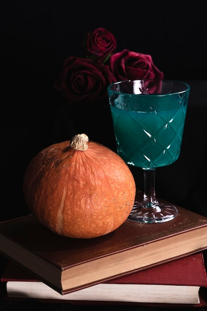 Pumpkin with roses and green drink Free Photo