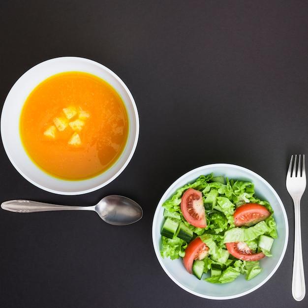 Pumpking soup and salad Free Photo