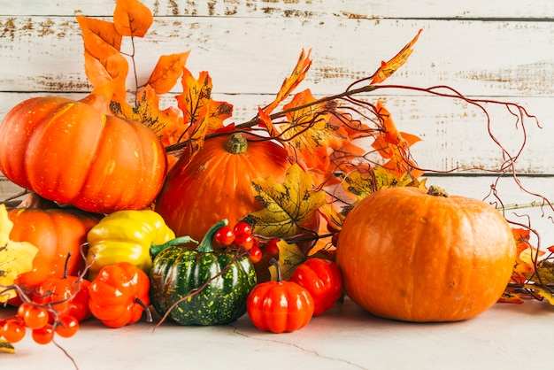 Pumpkins among colorful autumn leaves Free Photo
