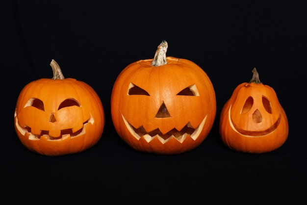 Pumpkins with carved faces for halloween celebration Premium Photo