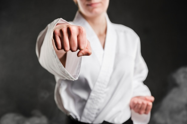 Punch of a karate woman Premium Photo