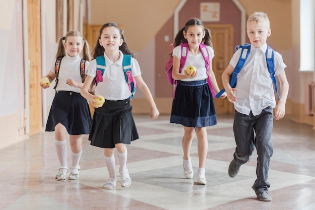 Pupils running on school hallway Free Photo