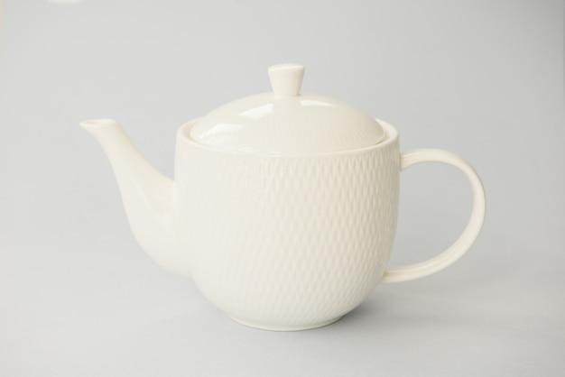 Pure white teapot on grey Premium Photo