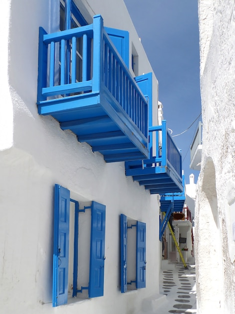 Pure white and vivid blue houses and a small alley at mykonos town, mykonos island of greece Premium Photo